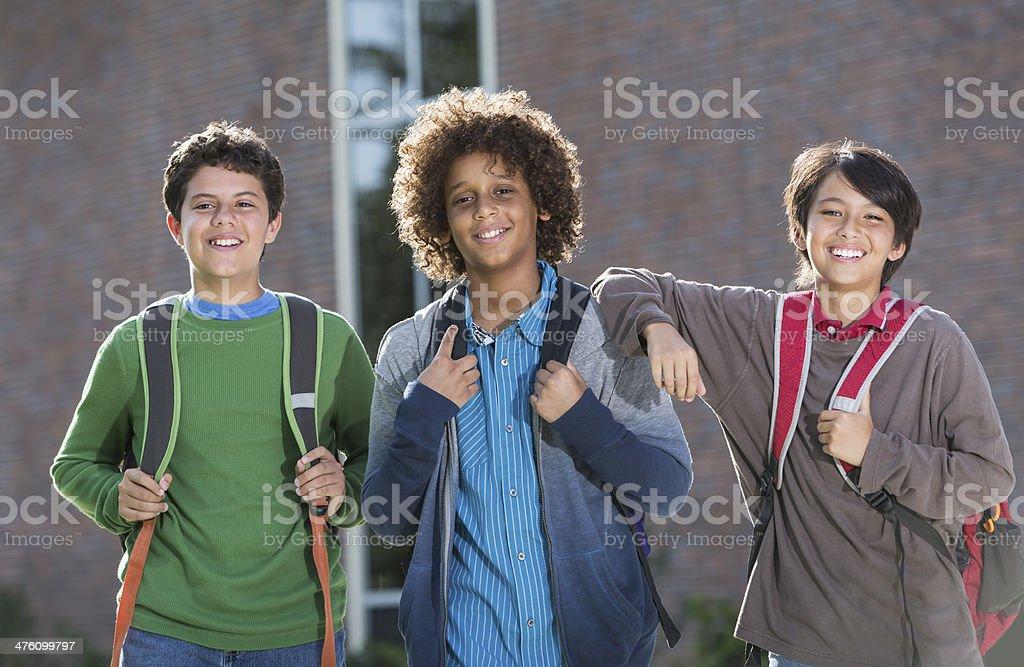 Boys standing outside school stock photo