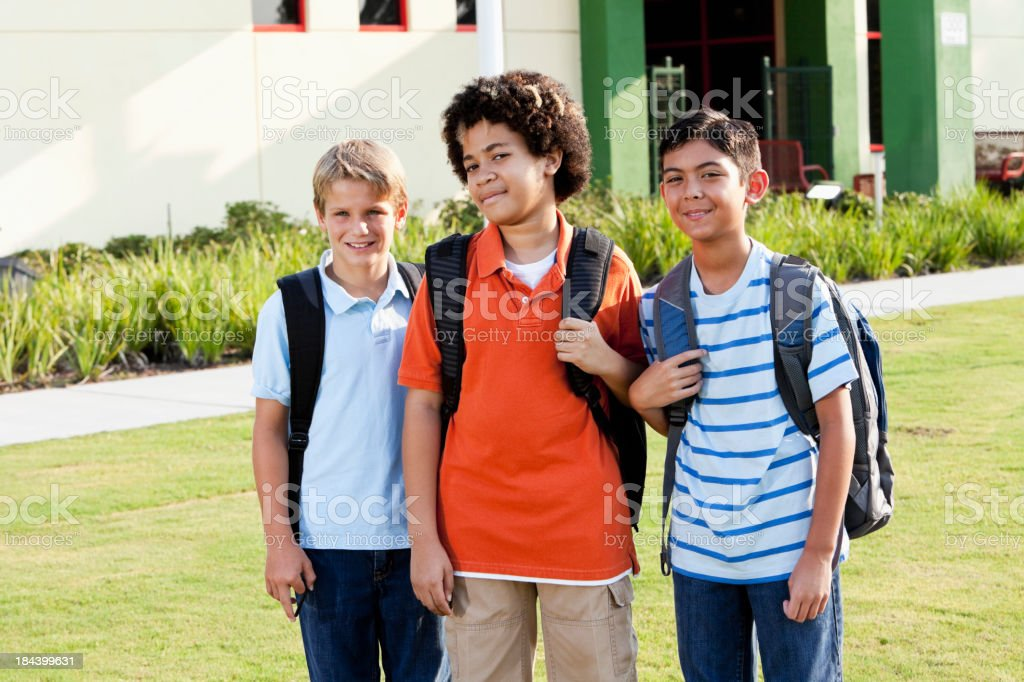Boys standing outside school with bookbags royalty-free stock photo