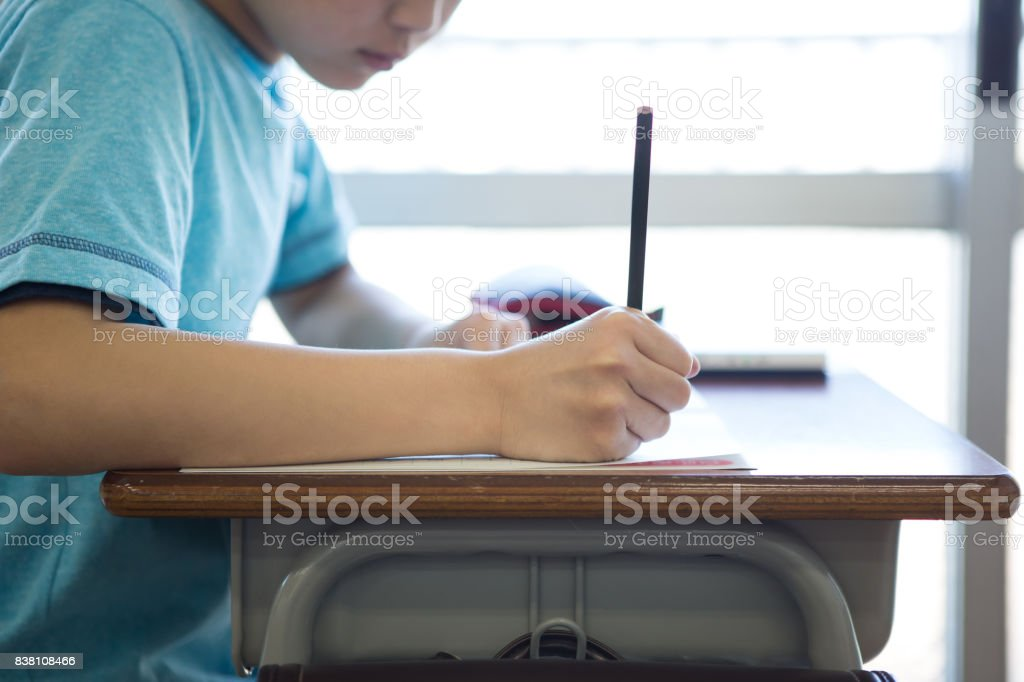 Boys studying in the classroom stock photo