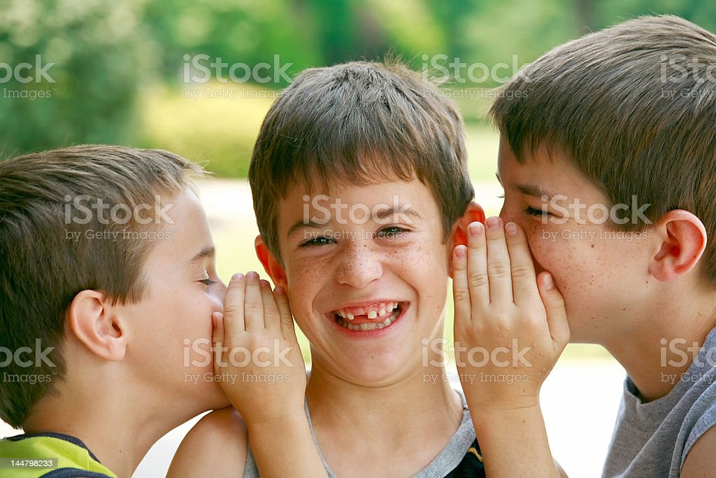 Boys Telling Secrets stock photo