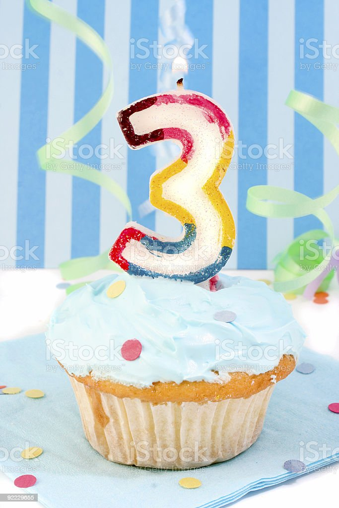 boy's third  birthday stock photo