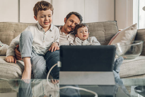 Boys watching a movie on tablet stock photo