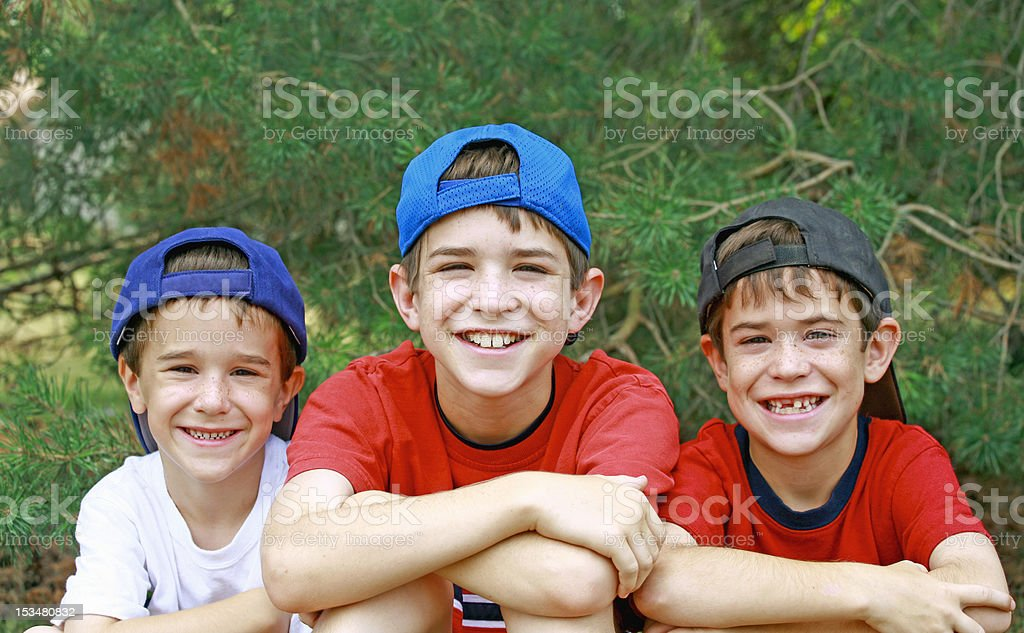Boys Wearing Baseball Hats stock photo