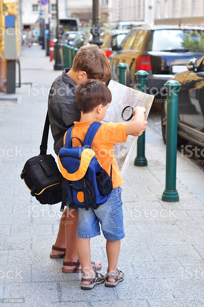 Boys with a map stock photo