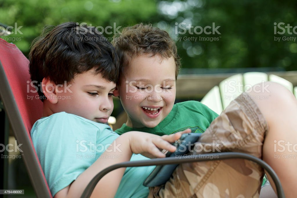 Boys with autism connect stock photo
