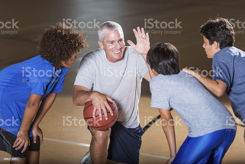 Boys with basketball coach stock photo
