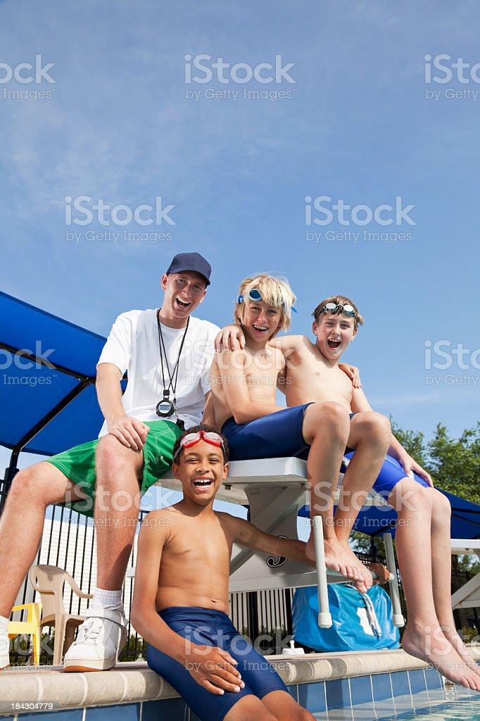 Boys with swim coach stock photo