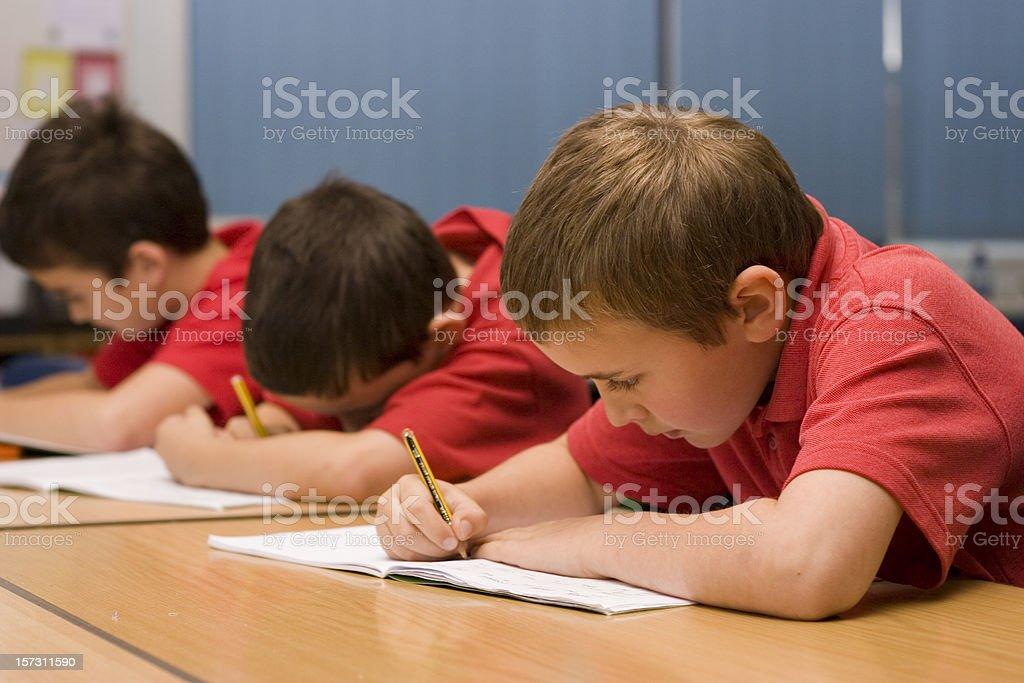 Boys writing royalty-free stock photo