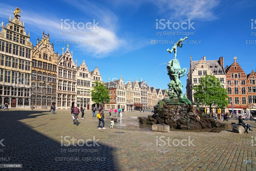 Brabo fountain on Grote Markt with traditional Flemish architecture....