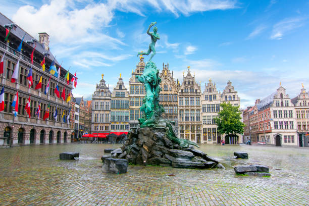 Brabo fountain on market square in Antwerp, Belgium Brabo fountain on market square in Antwerp, Belgium belgium stock pictures, royalty-free photos & images