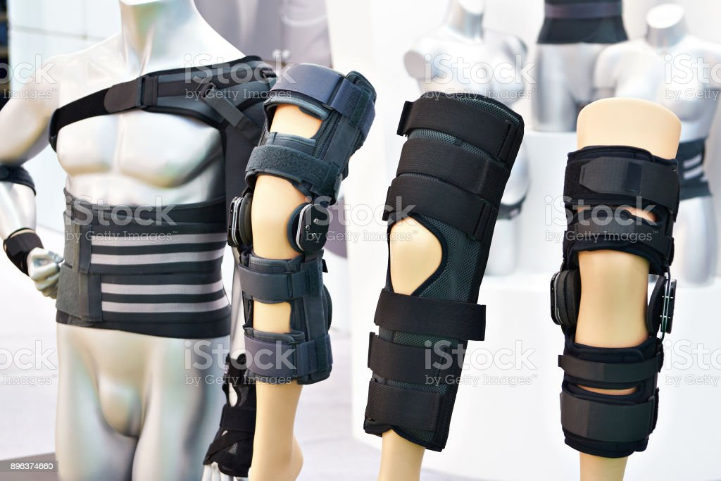 Brace on knee joint with sleeve made of neoprene in store stock photo