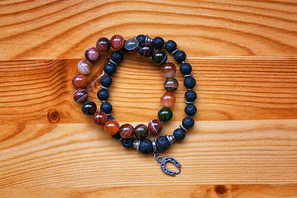 bracelet of lava stone and a stone agate - herren armband stock-fotos und bilder
