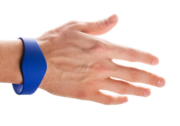 RFID Bracelet on a hand RFID Bracelet on a hand of man isolated on a white background radio frequency identification stock pictures, royalty-free photos & images
