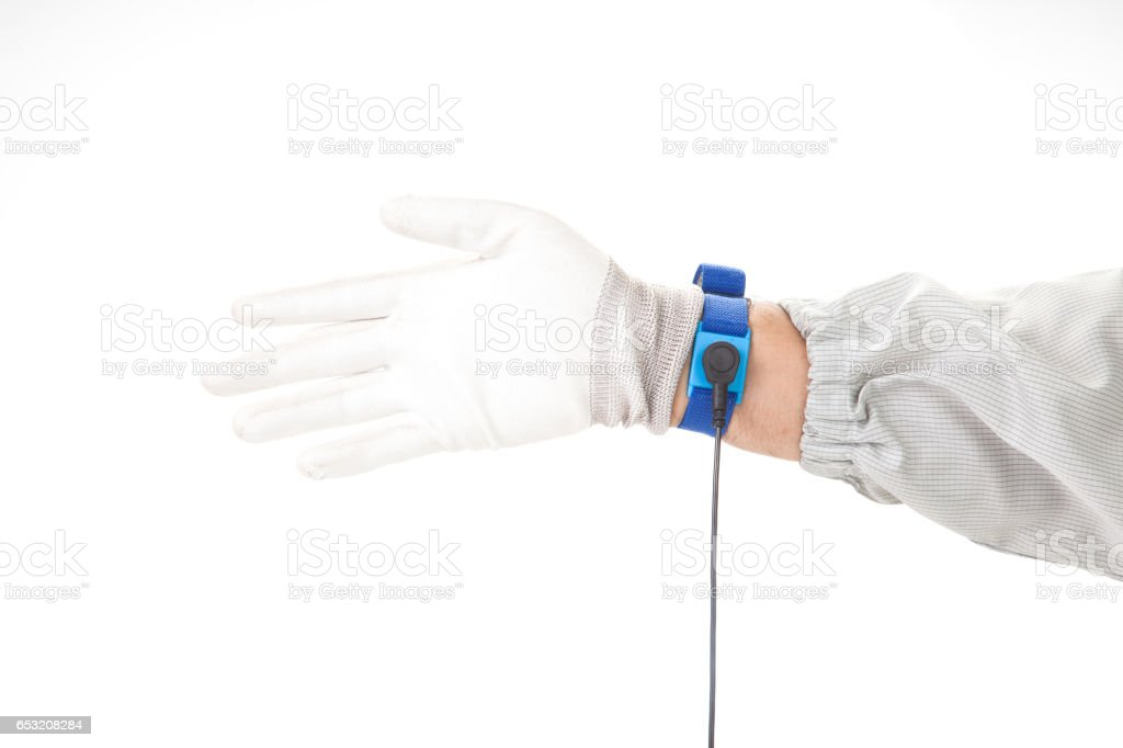 Bracelet on the hand of a man wearing ESD cloth and  glove static resistance (ESD) bracelet or ground equipment, anti-static, used to safely ground is working. electronic devices stock photo