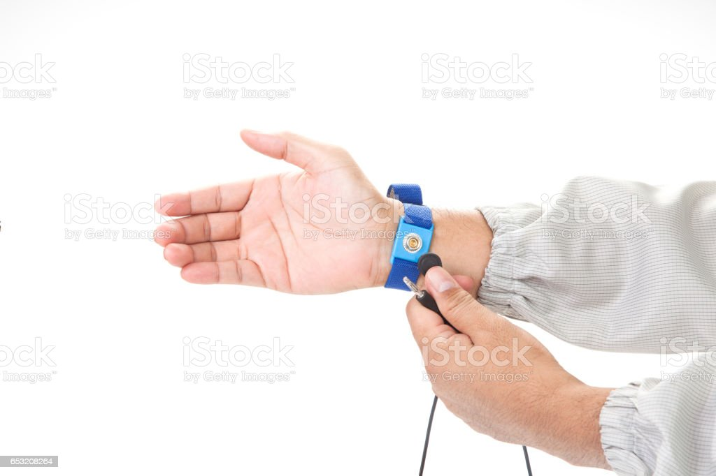 Bracelet on the hand of a man wearing ESD cloth isolated on white background static resistance (ESD) bracelet or ground equipment, anti-static, used to safely ground is working. electronic devices stock photo