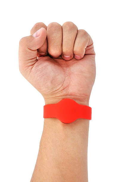 RFID  Bracelet RFID  Bracelet on his arm on a white background radio frequency identification stock pictures, royalty-free photos & images