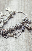 bracelet with charms. selective focus. Beauty and fashion.
