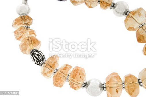 Bracelet with semi-precious stones isolated over white background