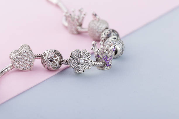 Bracelet with silver charm beads with gems stock photo