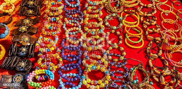 istock Bracelets and other handmade accessories on a bright red surface 480017332