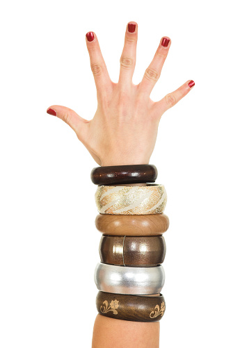 Different bracelets on woman's hand isolated on white background