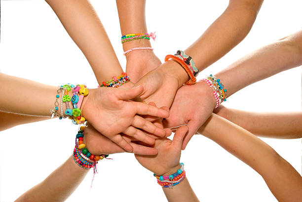 Bracelets Children hands. wristband stock pictures, royalty-free photos & images