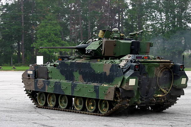 m2 bradley armored fighting vehicle on concrete yard - land vehicle stock photos and pictures
