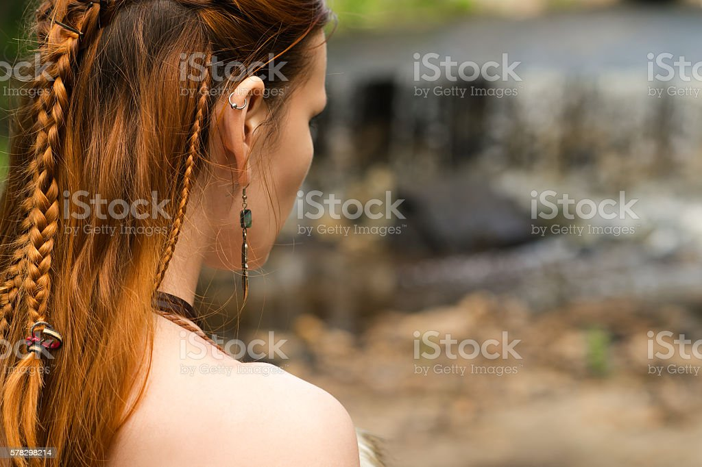 braid hairstyle on redhead woman stock photo
