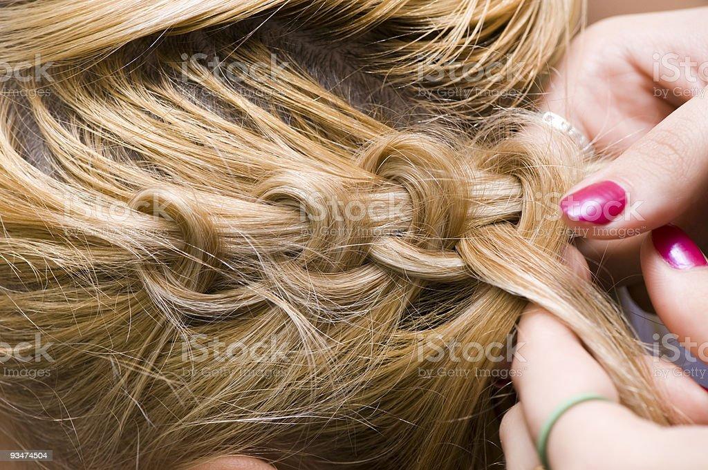 Braid one's hair royalty-free stock photo