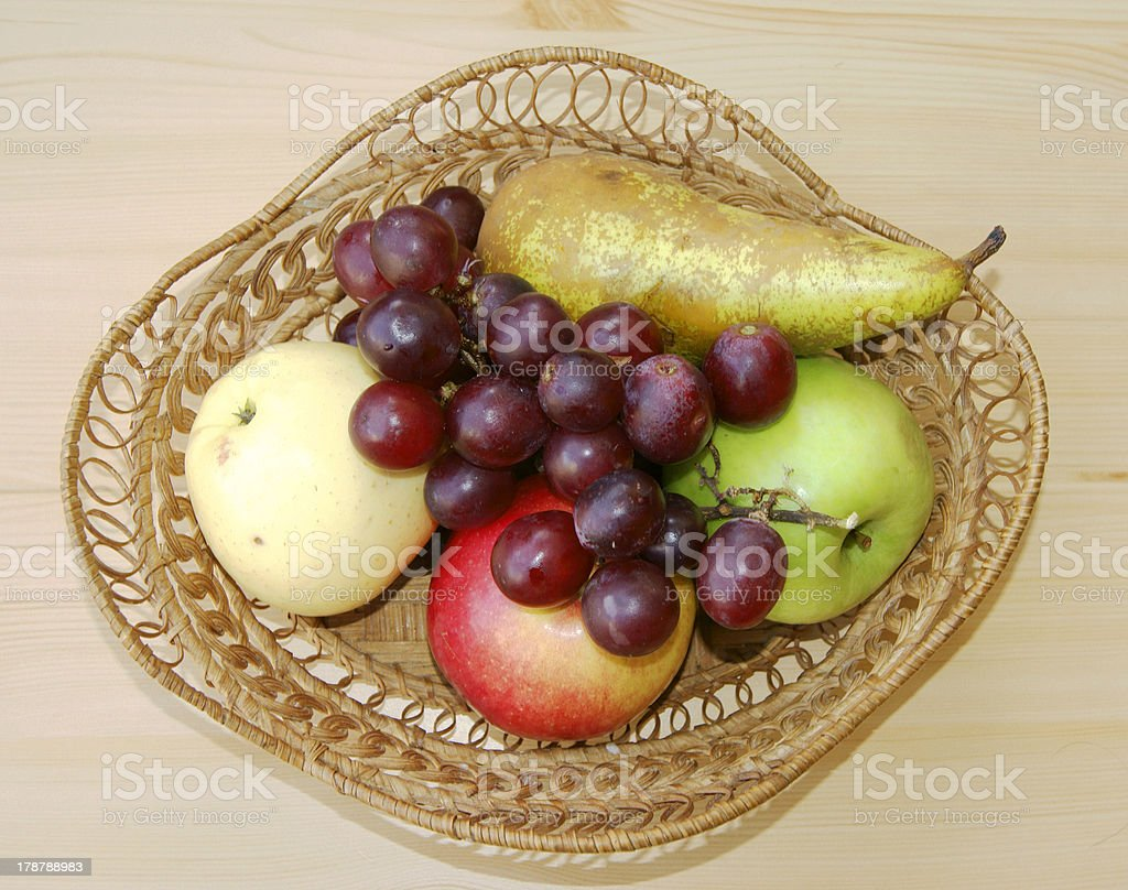 Braided basket with fruit royalty-free stock photo