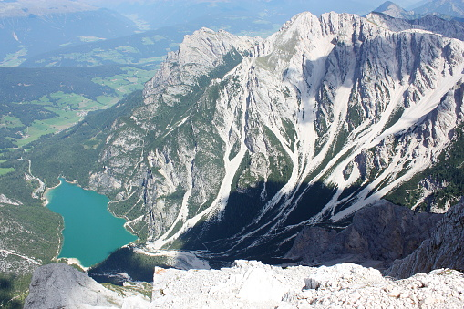 istock Braies alpine lake aerial view (Alto Adige) 619365690
