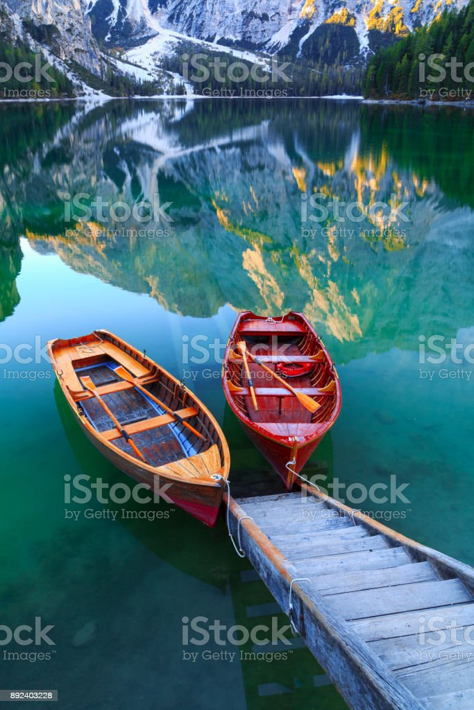 Braies lake and boats in the background of Seekofel mountain  ( Pragser Wildsee ) stock photo