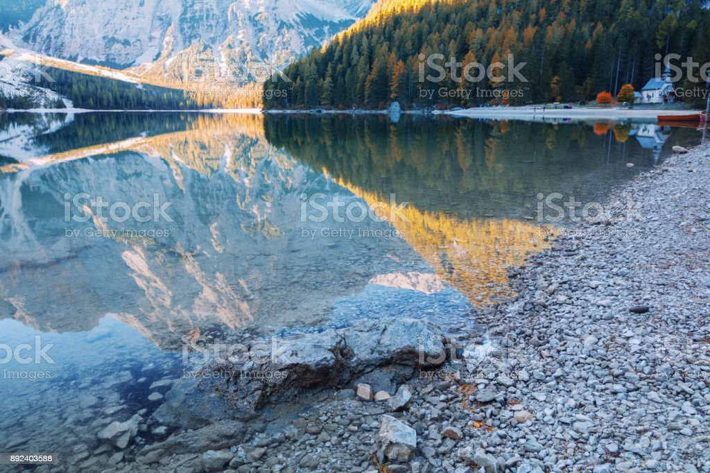 Braies lake and church in the background of Seekofel mountain ( Pragser Wildsee ) stock photo