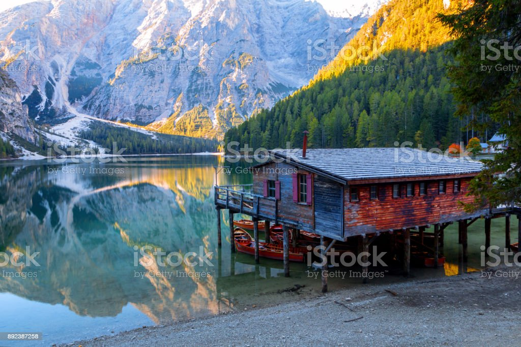 Braies lake and house in the background of Seekofel mountain ( Pragser Wildsee ) stock photo