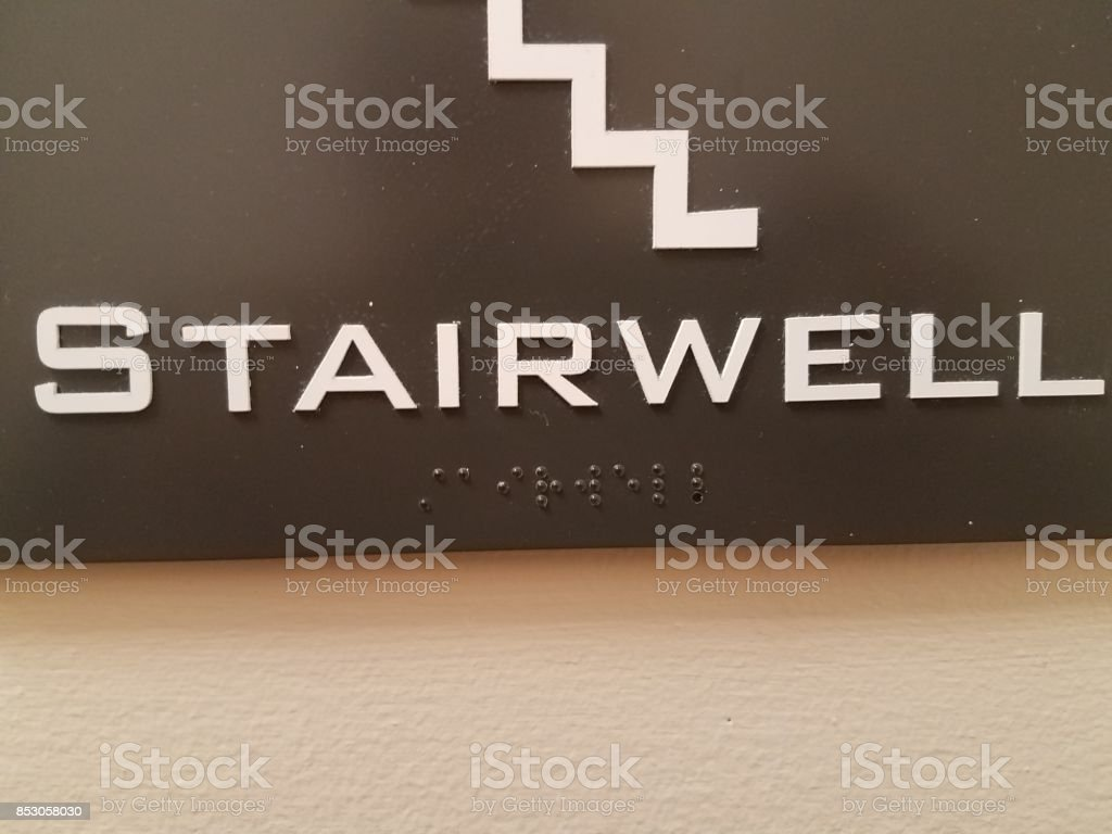 braill on a plastic sign stock photo
