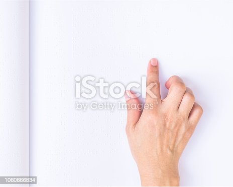 1017945546 istock photo Braille book for low vision/ blind person reading Braille sign by finger touching embossed texture paper for World sight day and World Braille day awareness concept 1060666834