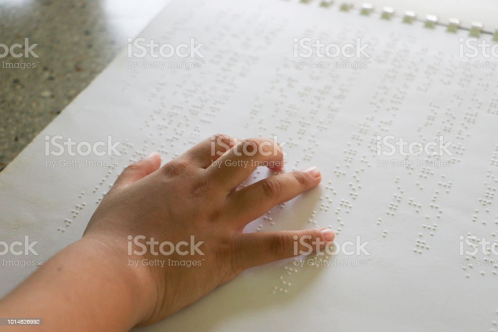 Braille is the font for the blind, invented by Louis Braille. The French blind teacher is a small convex dot in a six-point box, which is arranged alternately into code. Fine letters or mathematical symbols, science, music notes, etc stock photo