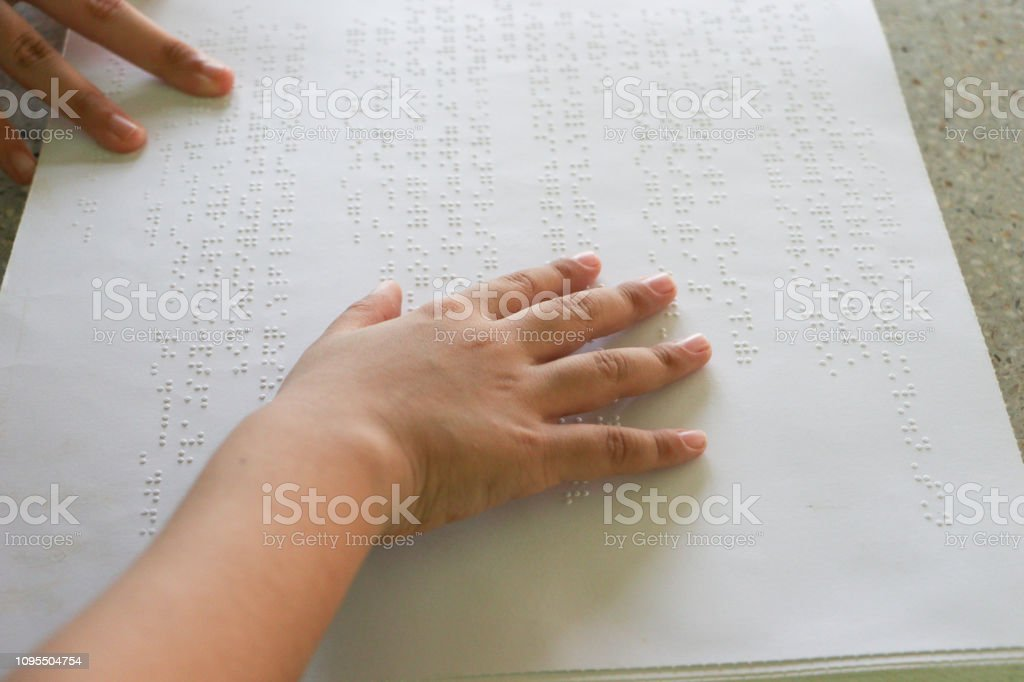 Braille is the font for the blind, invented by Louis Braille. The French blind teacher is a small convex dot in a six-point box, which is arranged alternately into code. stock photo