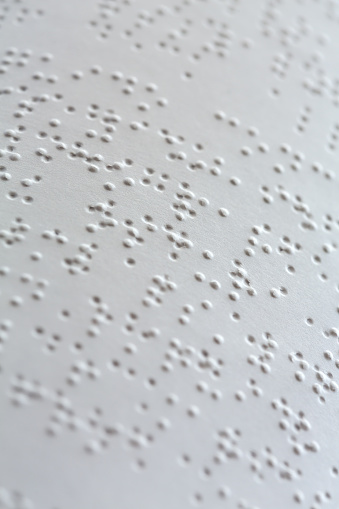 braille-white-page-of-book-with-text-picture-id629623112