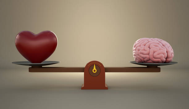 Brain and heart on a wooden balance scale. stock photo