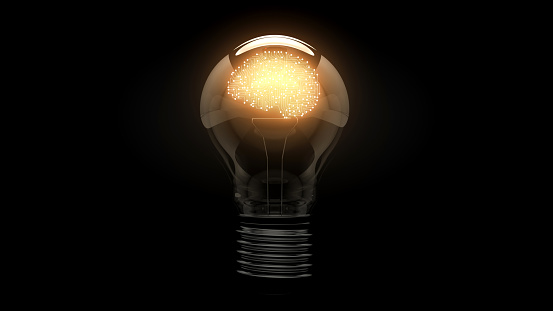 Brain as an electronic circuit. Glowing brain symbol in a light bulb on a black background. 3D. 3D rendering.