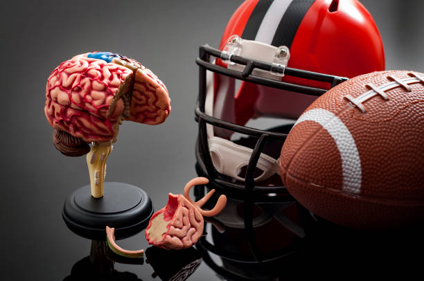 brain damage and sports injury concept - head injury stock photos and pictures