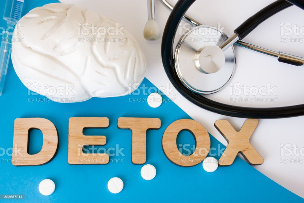 Brain detox concept photo. Word detox of volumetric letters is near 3D brain model and medical stethoscope. Medical diet program for detoxification and cleanse of brain, nerve and nervous system stock photo