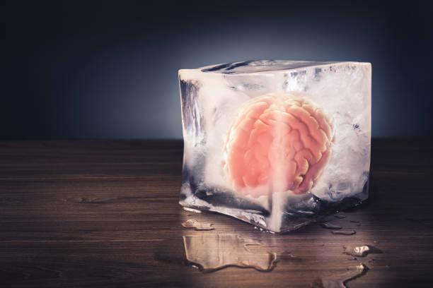 brain freeze concept with dramatic lighting - criobiologia foto e immagini stock