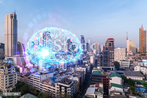 istock Brain hologram over panorama city view of Bangkok, the largest science hub in Asia. The concept of developing coding and high-tech science. Double exposure. 1323375667