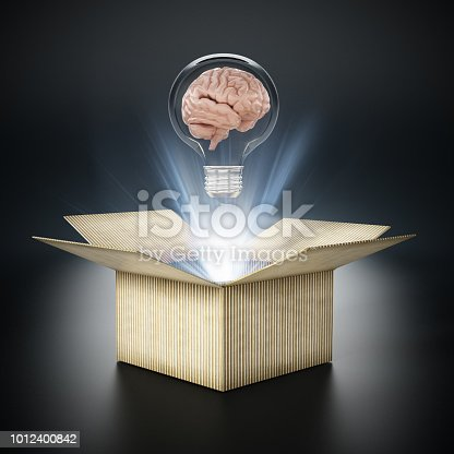 istock Brain inside lightbulb coming out the cardboard box. Thinking out of the box concept 1012400842