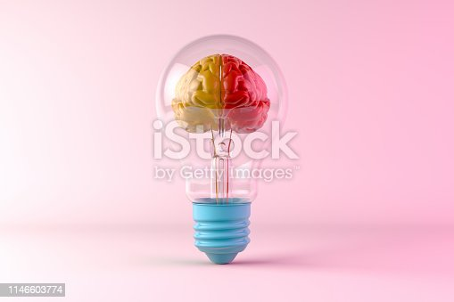 Ideas concept, brain inside the light bulb on colorful background.
