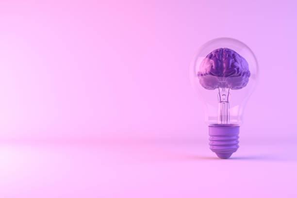 cérebro dentro da ampola, conceito creativo da idéia - rosa cor - fotografias e filmes do acervo