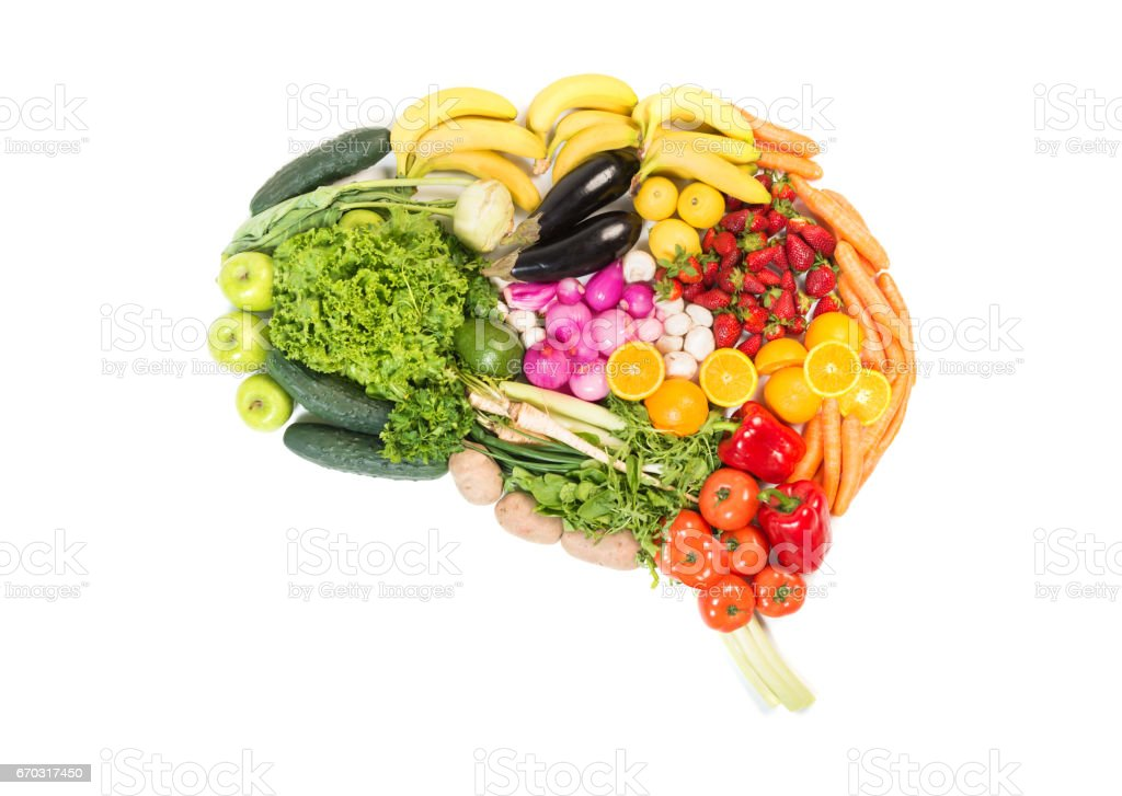 Brain made out of fruits and vegetables isolated on white background stock photo