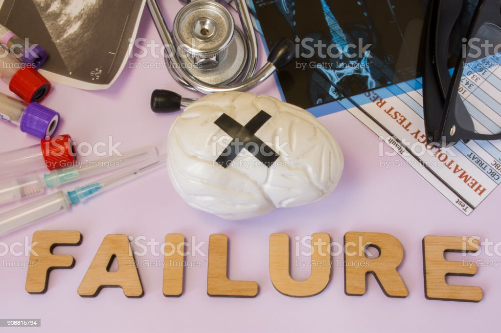 Brain, mental or cognitive failure concept photo. Brain with glued black cross is near word failure and set of medical tests (MRI, ultrasound, analysis), diagnostic devices (stethoscope, test tubes) stock photo